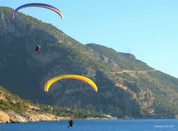 Paragliders Landing At Belcekiz