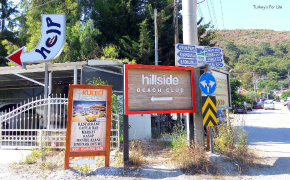 Help Beach & Yacht Club Signpost